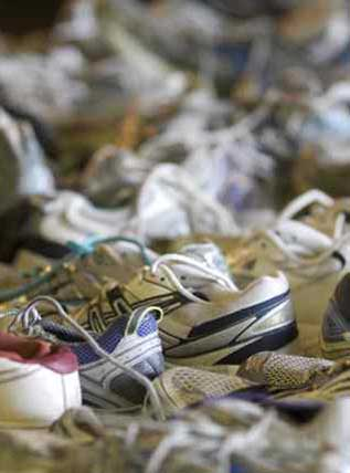 photo of a pile of recycled running shoes